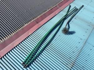 煙突掃除のロッドとブラシ